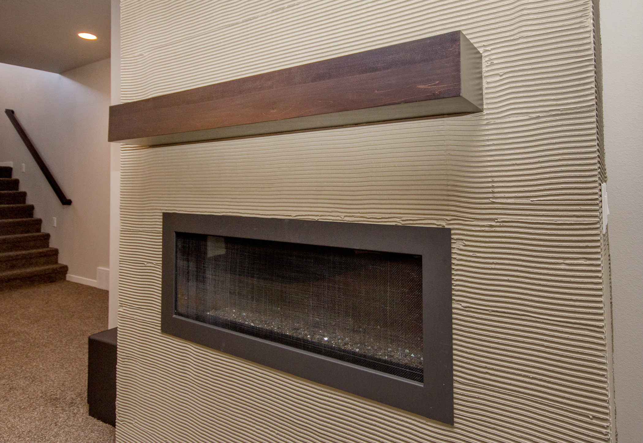 The sky is the limit when it comes to designing and selecting materials for your fireplace